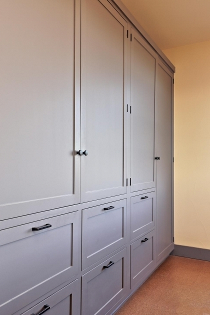 Alluring A Wall Of Built In Cabinets Provides Plenty Of Room To Store Basement Storage Cabinets